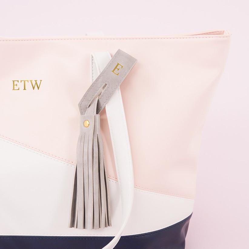 Grey personalised bag tassel on a pale pink monogrammed tote bag
