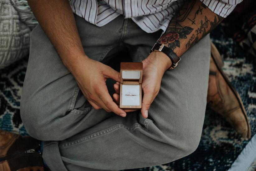 man holding engagement ring