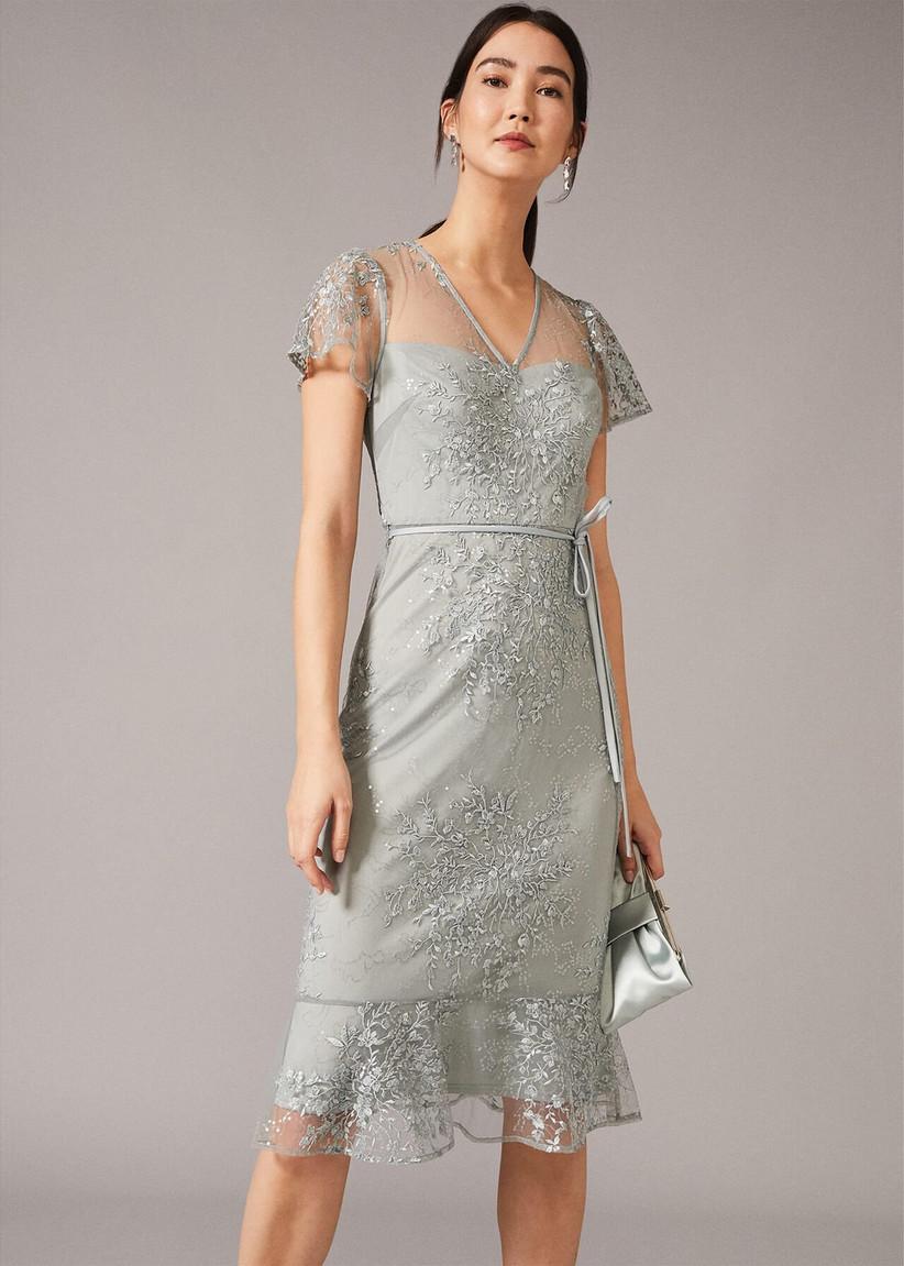 Girl wearing a silver lace dress