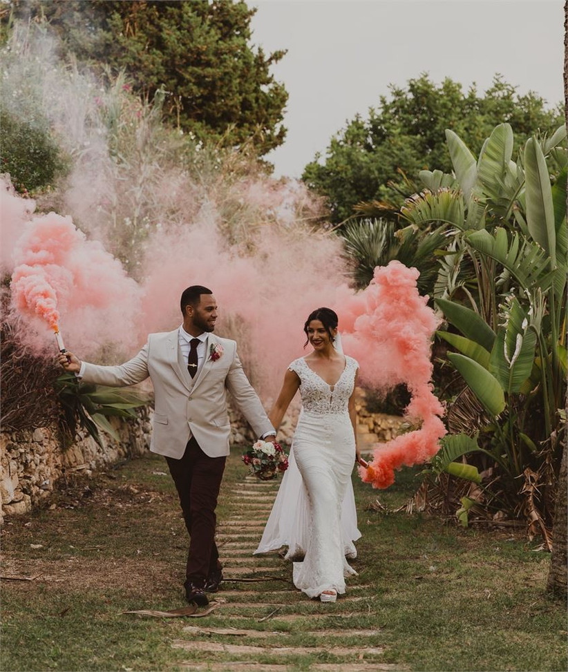 Bride and groom with a pink smoke stick