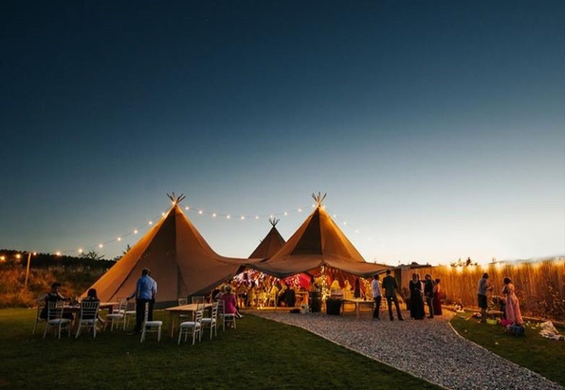 Wedding tipi lit up with fairy lights