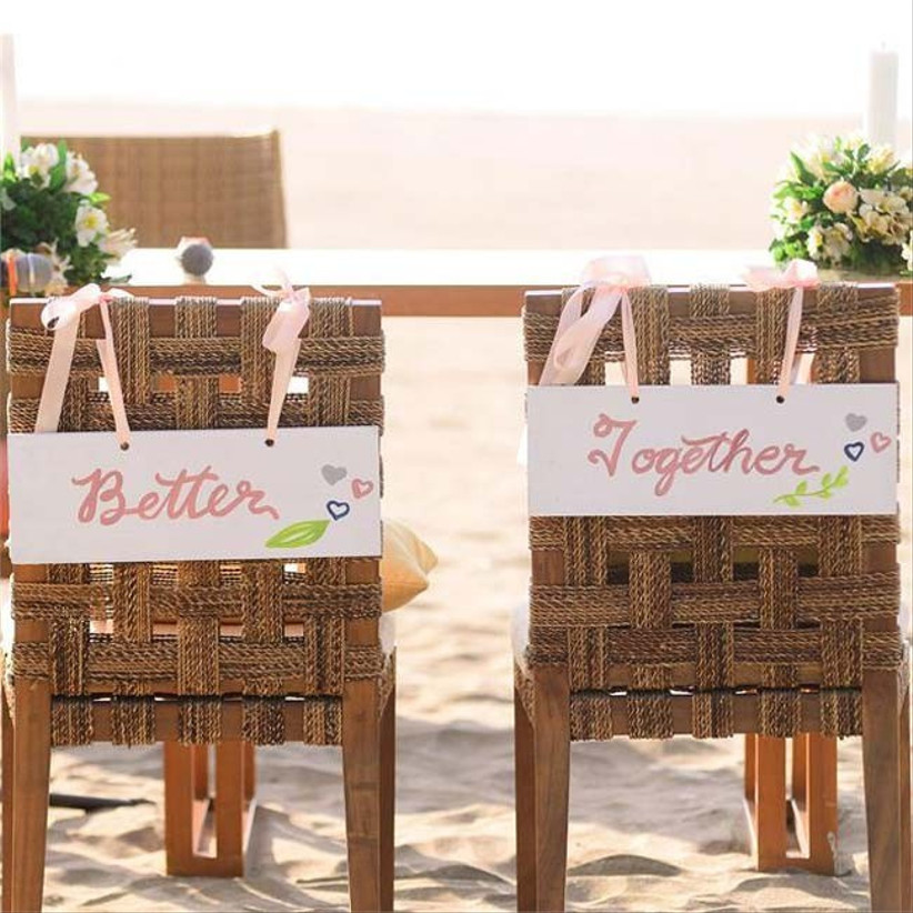 real-wedding-couple-denise-and-steve-had-matching-bride-and-groom-chairs-at-their-beach-wedding