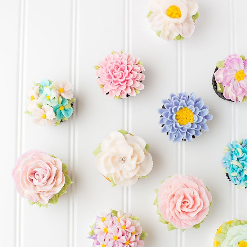 Floral iced mini cupcakes