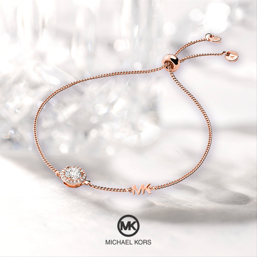 Rose gold friendship bracelet with a round cubic zirconia at the centre