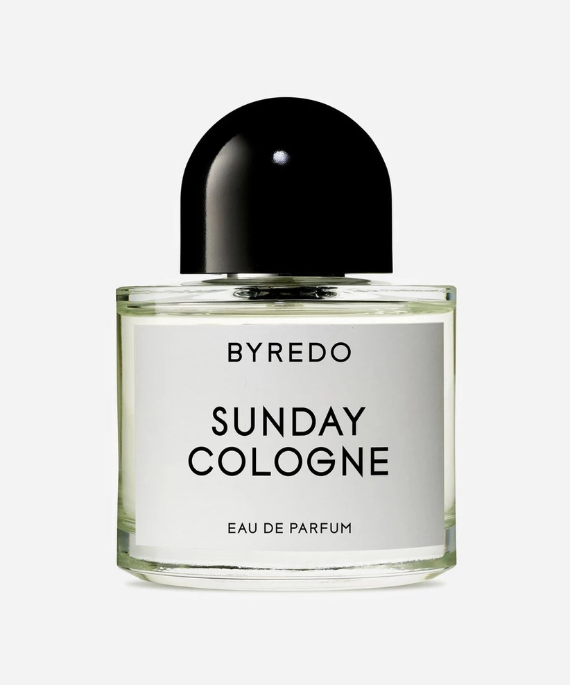 A bottle of Byredo Sunday Cologne with a heavy black lid and clear glass flask