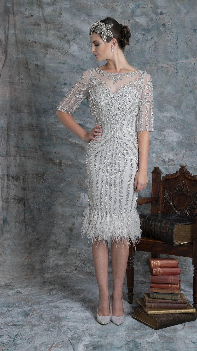 Girl wearing a silver sequin and feather midi dress
