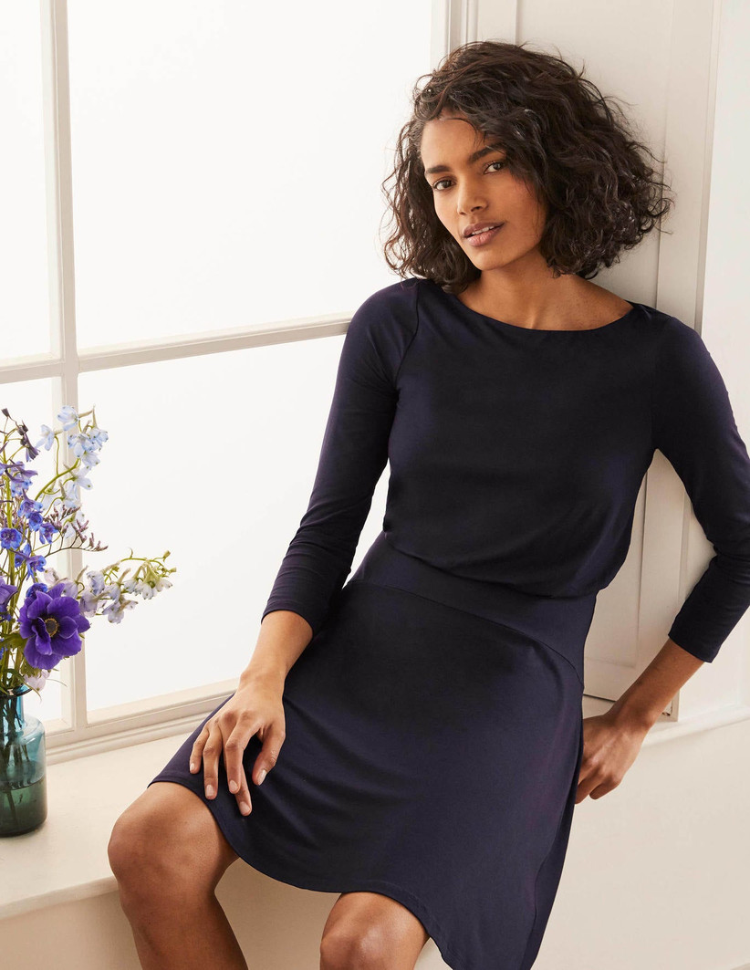 Girl wearing a classic navy mid sleeve dress