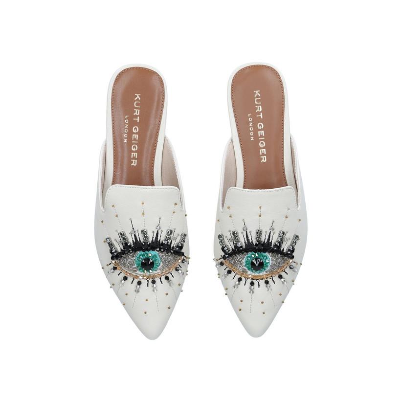 Eye embellished flat shoes