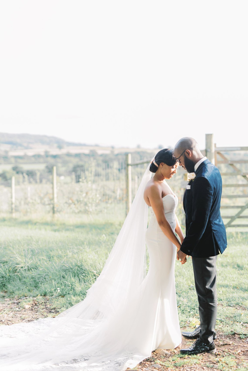 Bride and groom next to a field