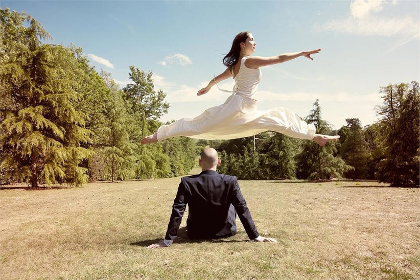 bride-leaping-over-groom-2