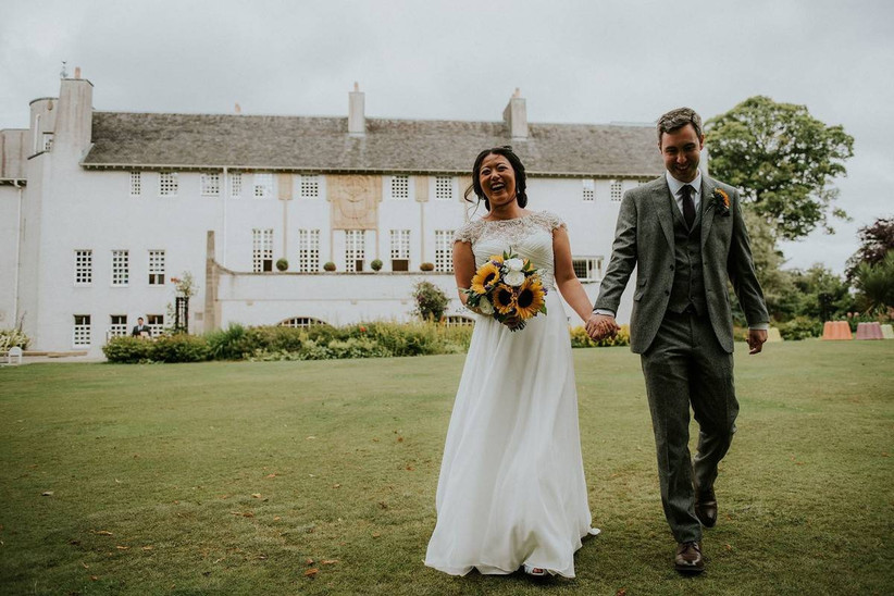 Bride and groom standing outside a beautiful venue