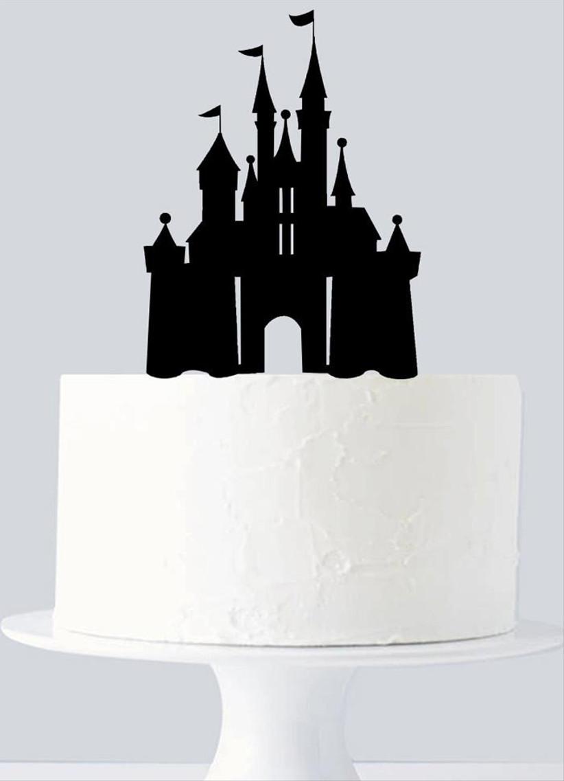 plain-wedding-cake-with-disney-castle-cake-topper