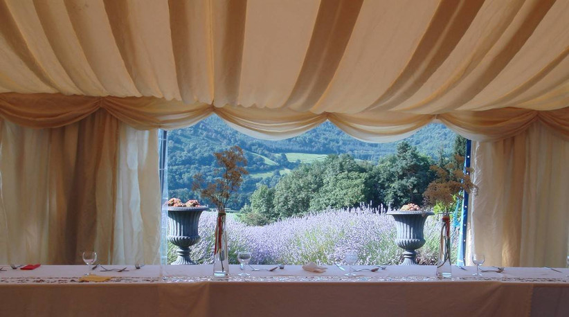 Marquee with table and views of the countryside and a lavender field