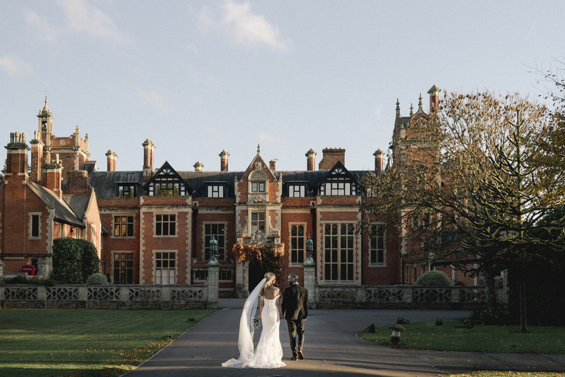 Exterior of Frensham Heights with a bride and groom in front