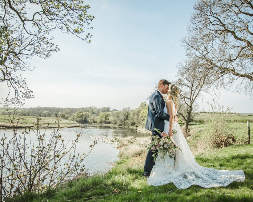 Bride and groom kissing at Lancashire wedding venue Hobbit Hill