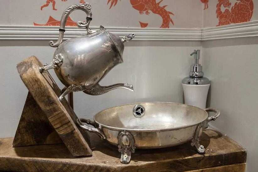 Silver teapot sink