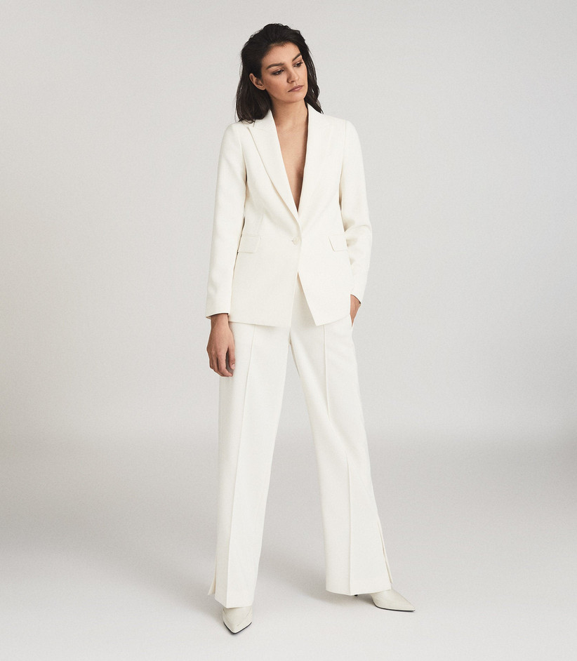 Model wearing a white trouser suit