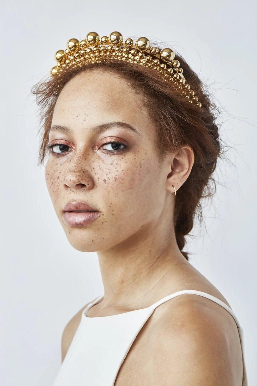 Girl wearing a gold crown with bronze eyelids