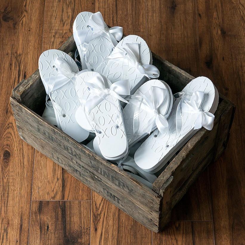 White xo flip flops in a wooden box