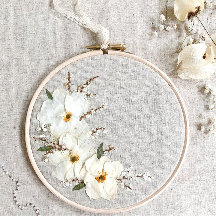 Embroidery hoop with white floral decorations