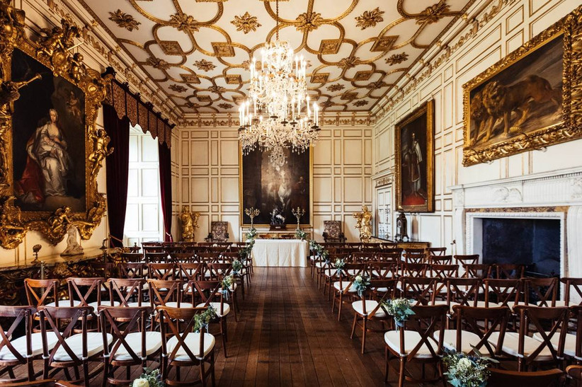 Grand ceremony room with oil paintings and gold details