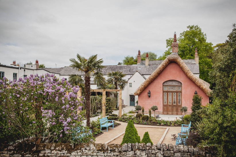 Pink chateau in a garden setting