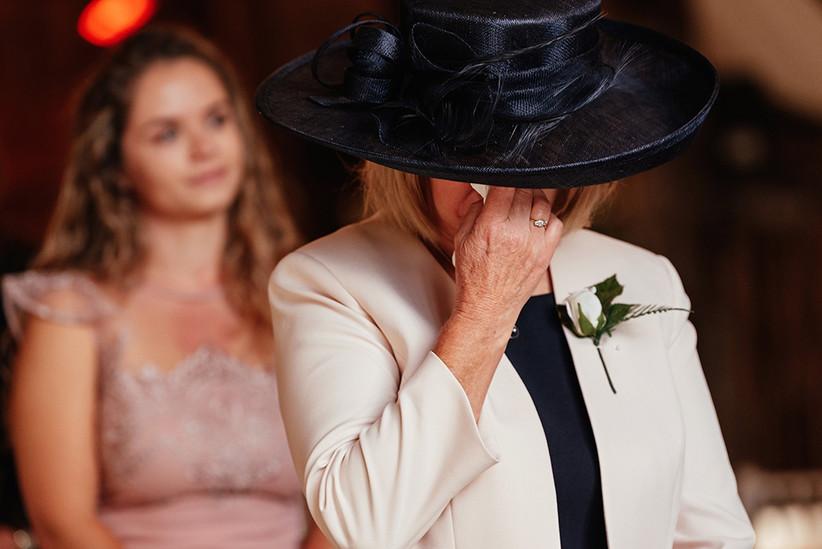 A female wedding guest crying