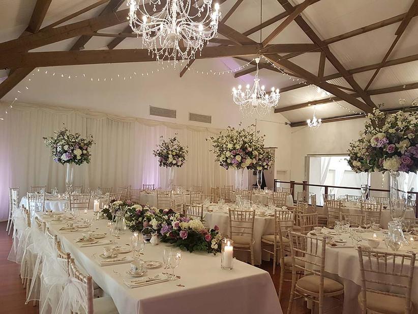 Interior of oak-beamed barn at Northamptonshire wedding venue Brampton Grange Estates