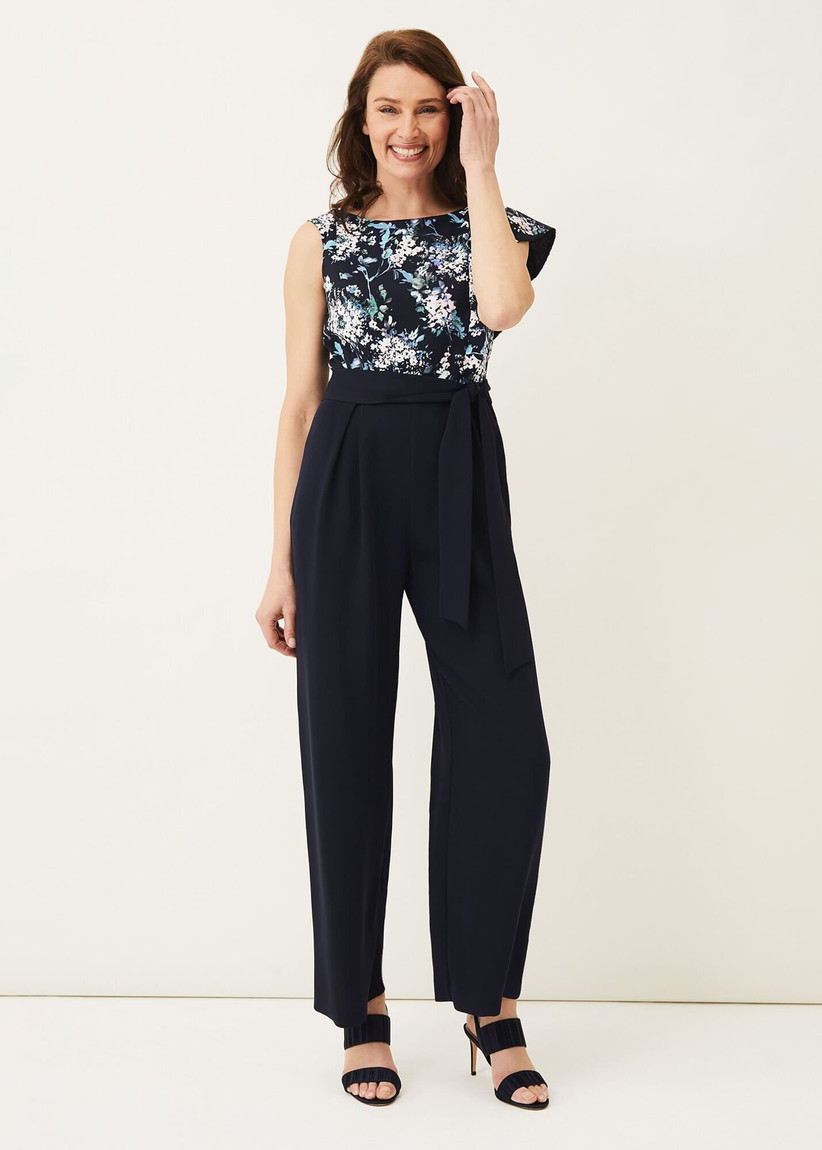 Jumpsuit with black trousers and a black and white floral top