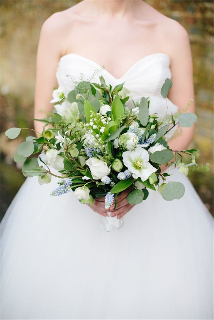 a-bride-holding-a-finished-bouquet-from-louise-avery-flowers