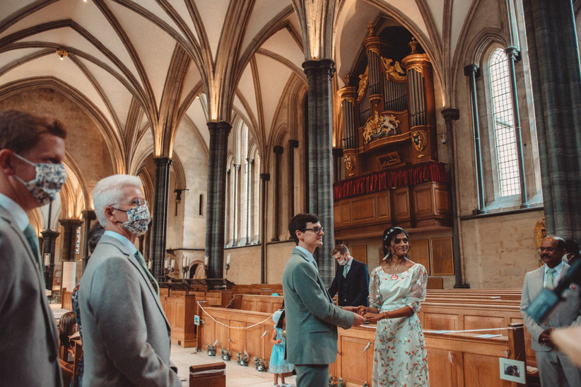 Nirosha and Dafydd holding hands in the church