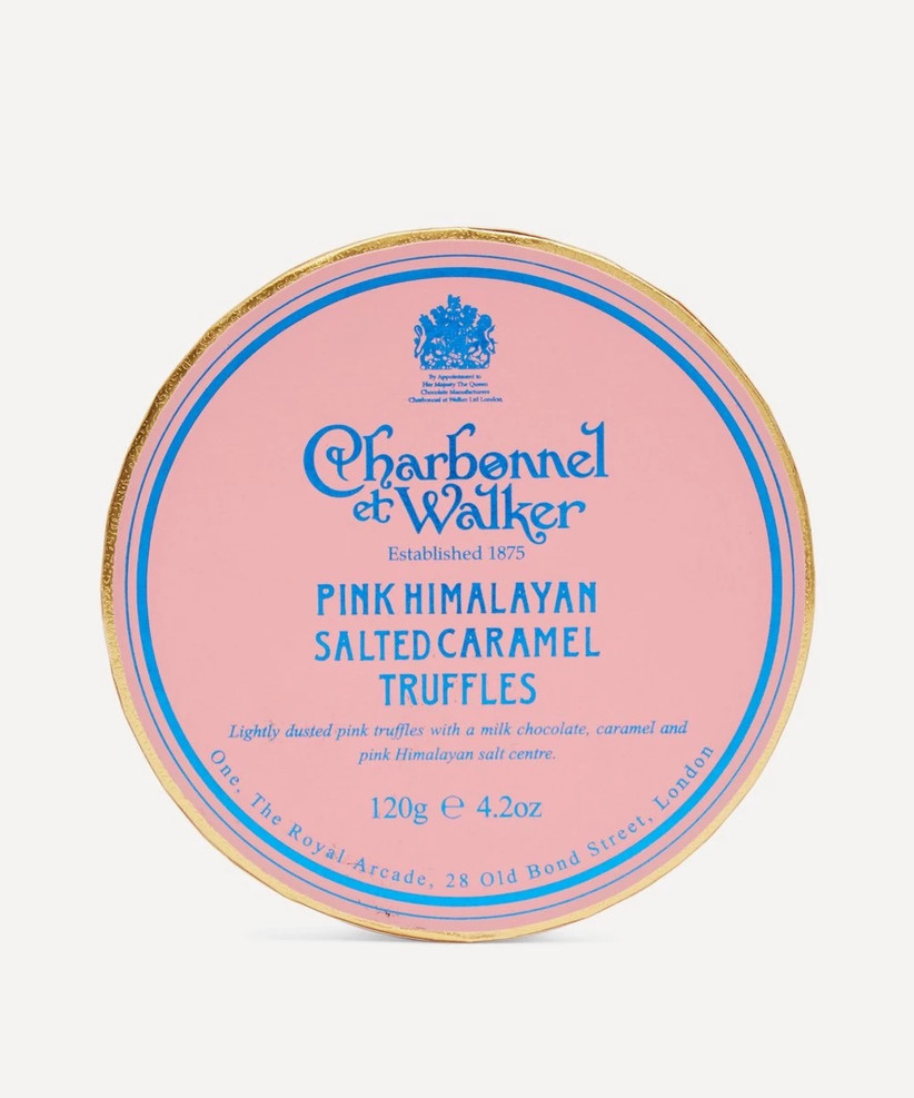 Round light pink box of Charbonnel et Walker pink Himalayan salted caramel truffles with a blue and gold border
