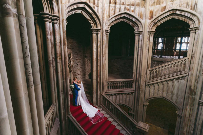 Bride and groom on the steps in a mansion