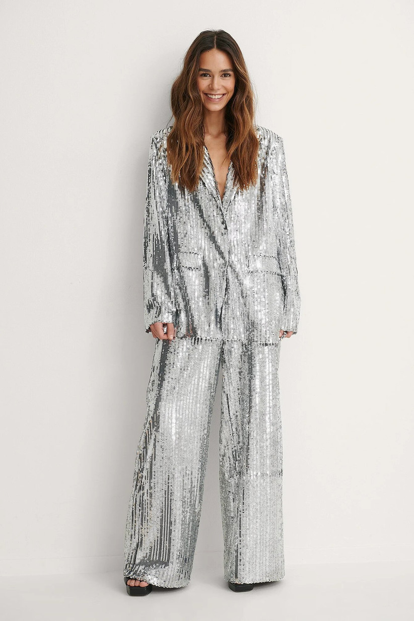 Girl wearing a silver sequin suit