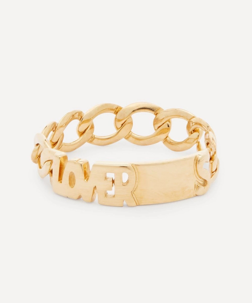 Gold chain style ring reading Lover in the centre