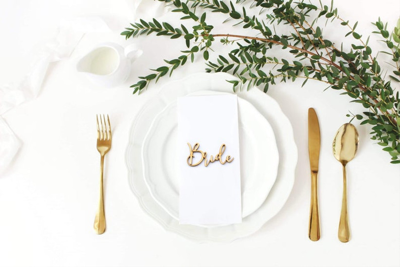 Wooden cut out wedding favour on a table place