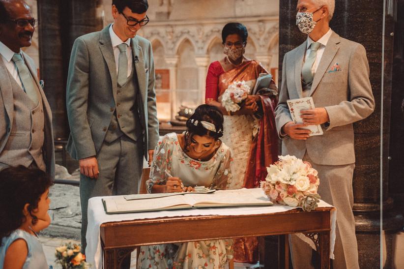 Nirosha signing the register