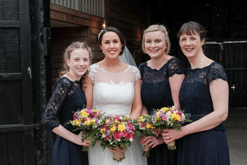 bride-and-bridesmaids-with-colourful-spring-wedding-bouquets