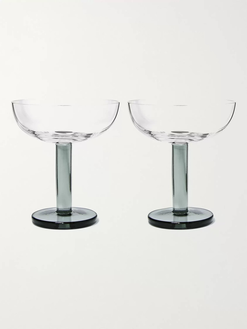 Two modern glass coupe glasses with smokey grey stems