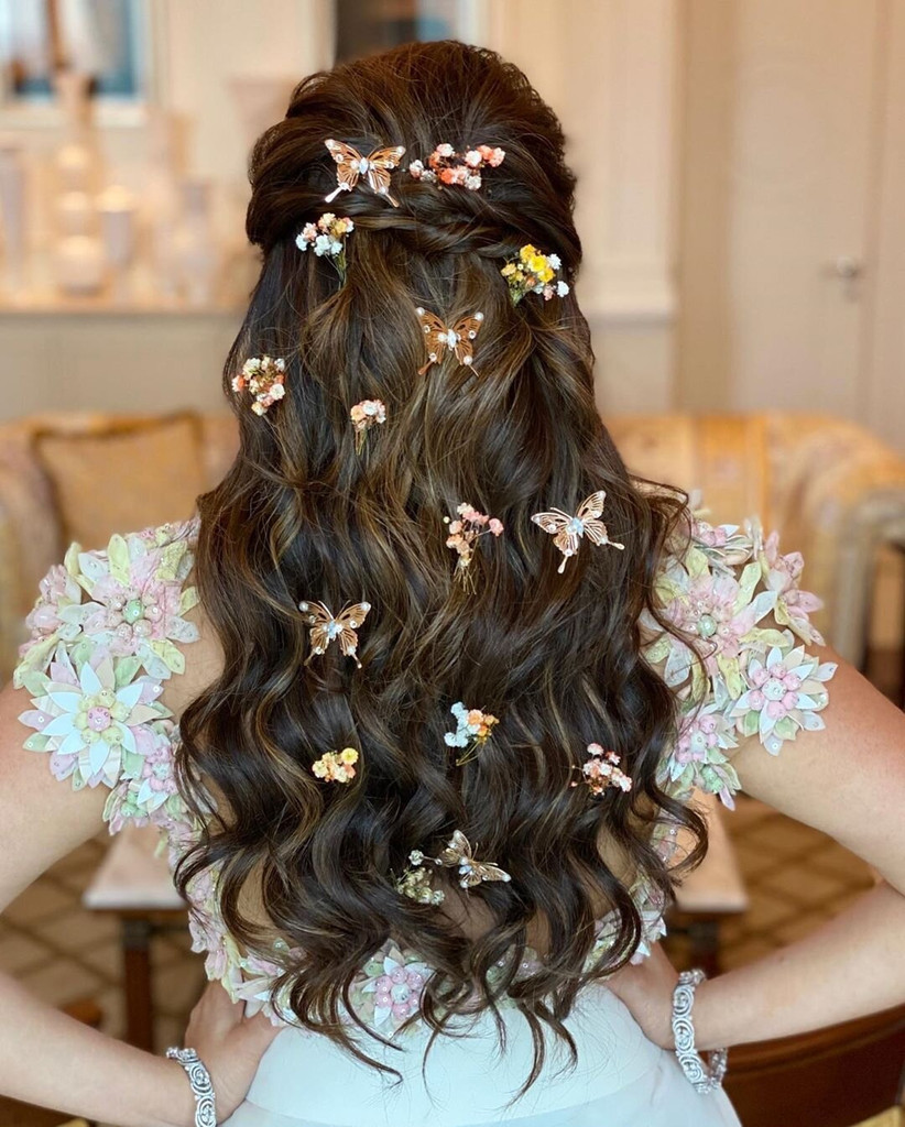 Half up half down hairstyle with butterflies