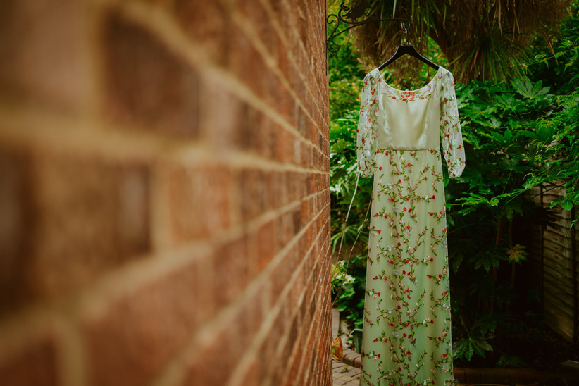 Nirosha's wedding dress on a hanger