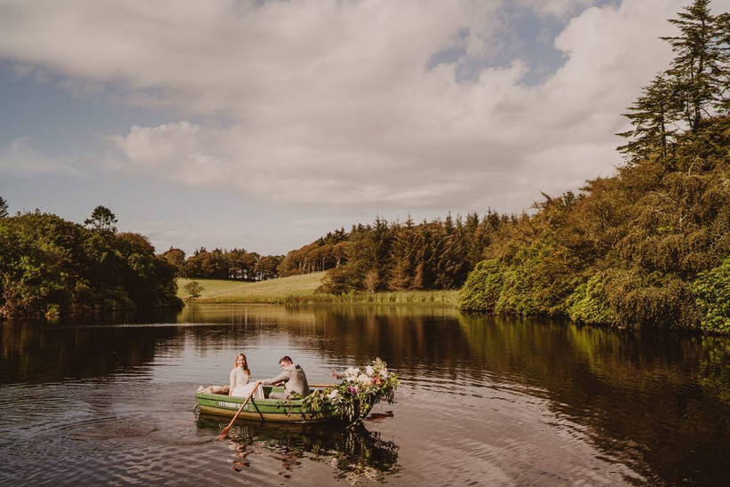 Bride and groom in a boat on a lake