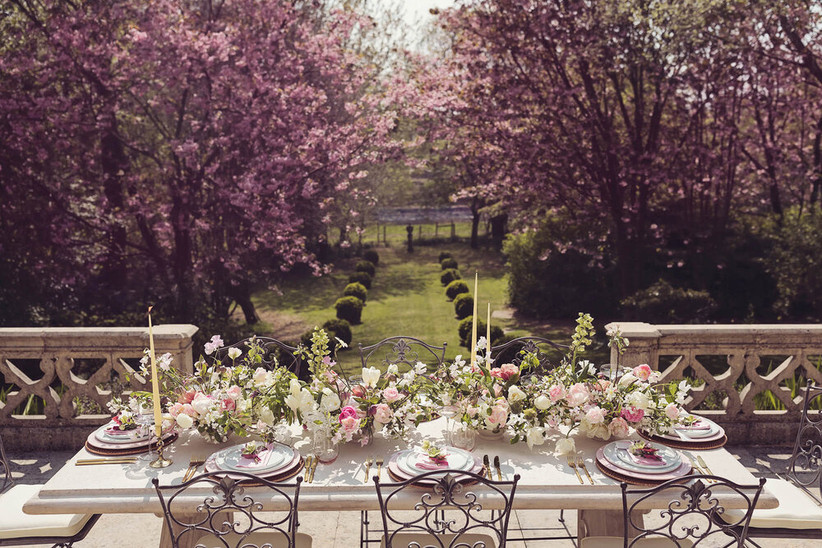 Wedding reception table in the garden of Lancashire wedding venue Casterton Grange