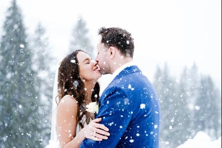 A Snowy Austrian Destination Wedding with Horse-Drawn Carriages + Two Wedding Dresses