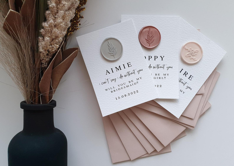 Cream cards with pastel metallic wax seals and personalised will you be my bridesmaid messages