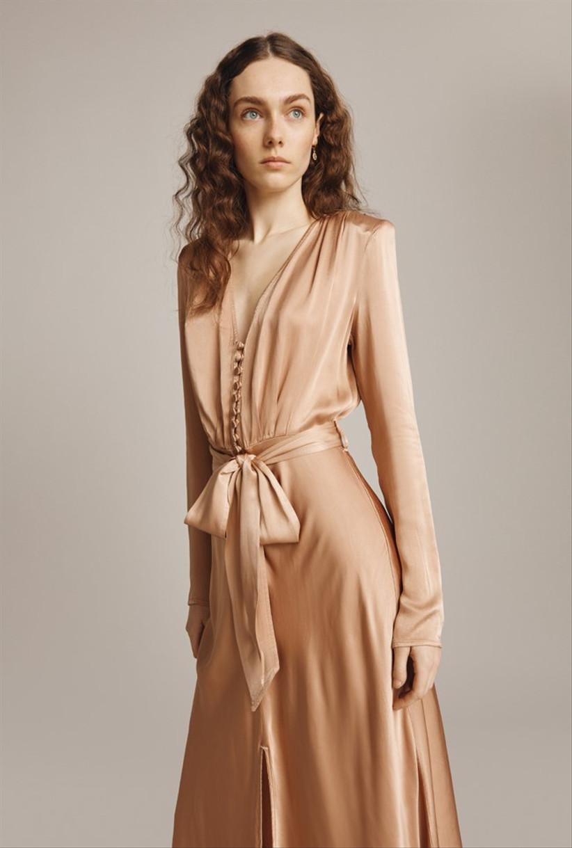 Girl wearing a stone satin button dress