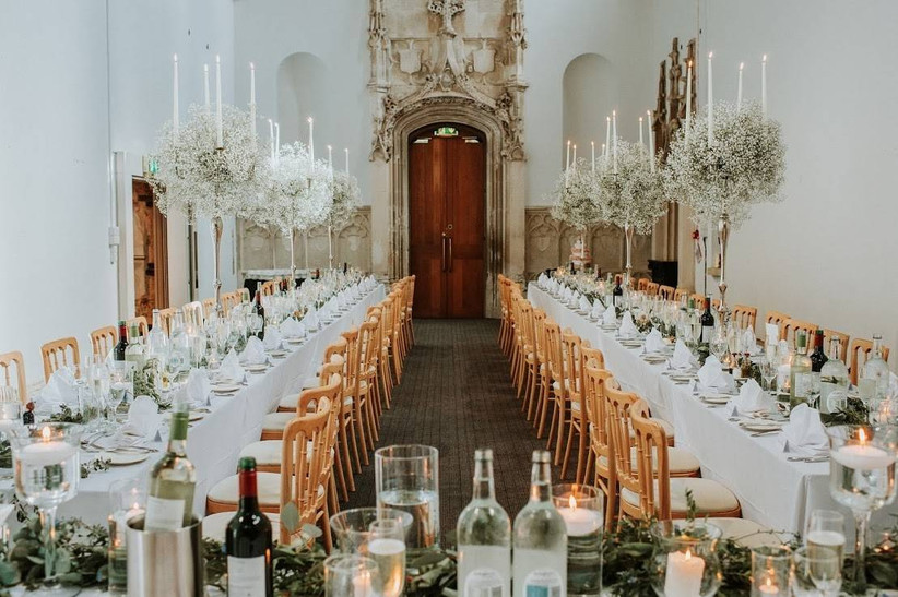 Dining area with chandeliers and white floral decorations