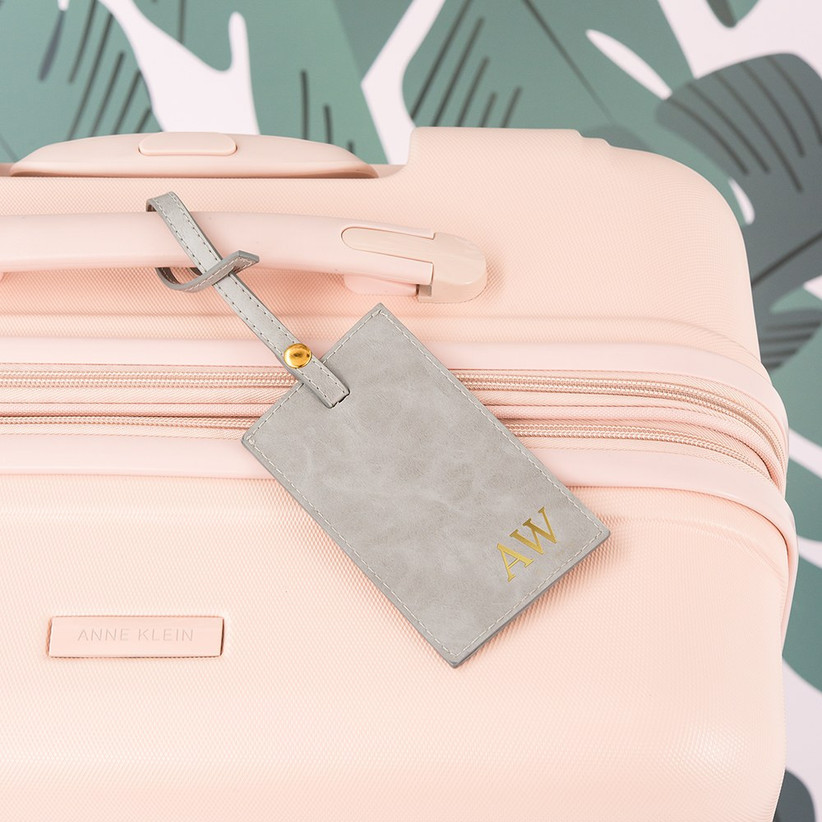 Personalised luggage tag on a pink suitcase