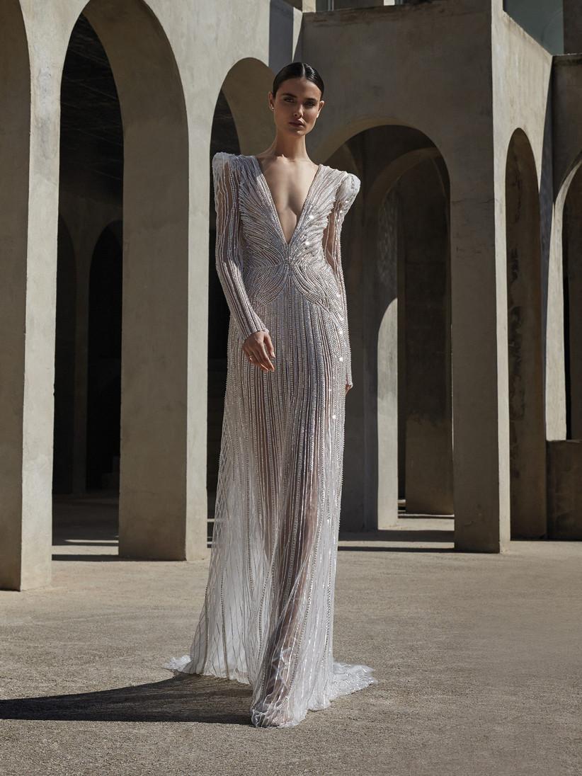 Model wearing a sequin long sleeved wedding dress