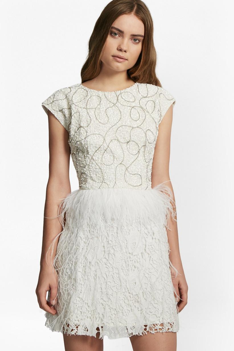 Model wearing a feather mini wedding dress
